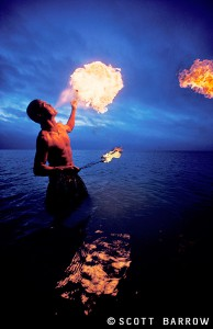 A fire blower lights up the pre dawn sky in Key West, Florida.